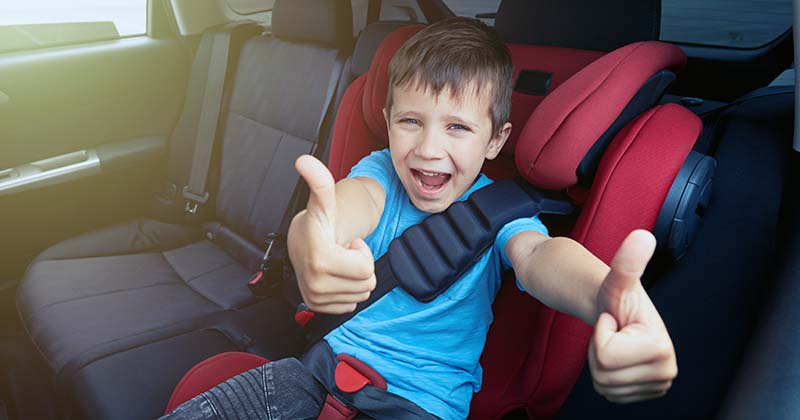 Happy boy in car